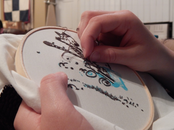 My sister embroidering Calvin and Hobbes