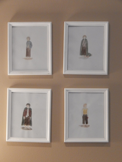 My four water color hobbits above my bed