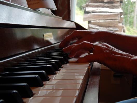 Grandma playing hymns on Sunday morning